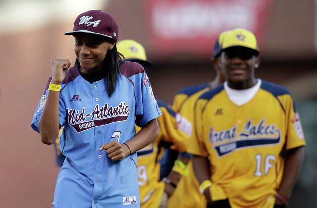 SAN FRANCISCO, CA - OCTOBER 25:  Little League Baseball pitcher Mo'ne Davis reatcs after she throws out the ceremonial first pitch before Game Four of the 2014 World Series at AT&T Park on October 25, 2014 in San Francisco, California.  (Photo by Ezra Shaw/Getty Images) ORG XMIT: 519100325 Photo: Ezra Shaw / 2014 Getty Images
