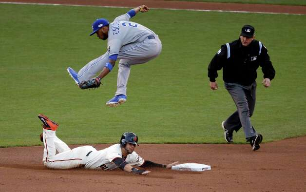 San Francisco Giants' Gregor Blanco steals second under the tag of Kansas City Royals' Alcides Escobar during the first inning of Game 4 of baseball's World Series Saturday, Oct. 25, 2014, in San Francisco. (AP Photo/Charlie Riedel)  ORG XMIT: WS525 Photo: Charlie Riedel / AP