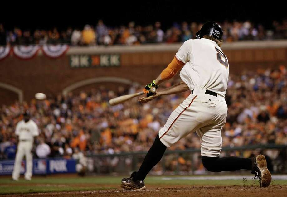 San Francisco Giants Hunter Pence hits an RBI double to score Joe Panik during the seventh inning of Game 4 of baseball's World Series against the Kansas City Royals Saturday, Oct. 25, 2014, in San Francisco. (AP Photo/Matt Slocum) Photo: Matt Slocum, Associated Press / AP