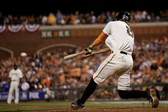 San Francisco Giants Hunter Pence hits an RBI double to score Joe Panik during the seventh inning of Game 4 of baseball's World Series against the Kansas City Royals Saturday, Oct. 25, 2014, in San Francisco. (AP Photo/Matt Slocum)