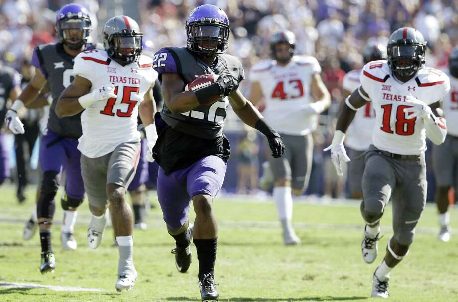 TCU running back Aaron Green sprints past Tech defensive back Keenon Ward (left) and linebacker Micah Awe for a TD. The Frogs set school records for points (82) and yards (785) in a game. Photo: Tony Gutierrez / Associated Press / AP