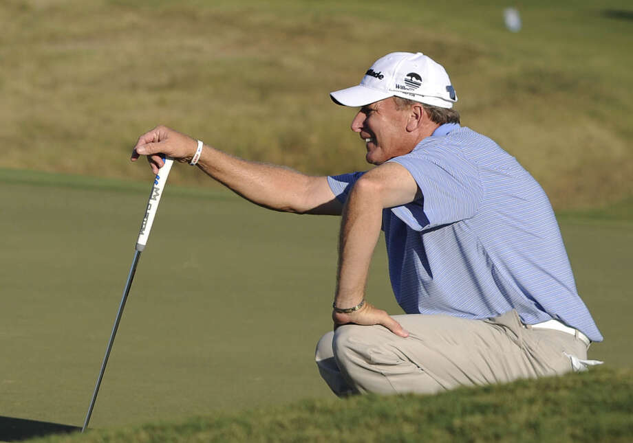 Woody Austin prepares to putt on No. 18 during the second round. Austin's 65 consisted of five birdies and an eagle. Photo: Billy Calzada / San Antonio Express-News