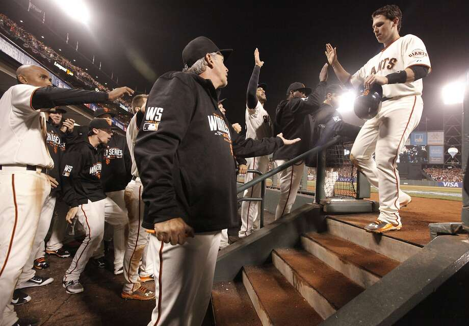 Giants' Buster Posey scores a run on a Pablo Sandoval single in the sixth inning, as the San Francisco Giants went on to beat the Kansas City Royals 11-4 in game four of the World Series at AT&T Park in San Francisco, on Saturday Oct.25, 2014. Photo: Michael Macor, The Chronicle