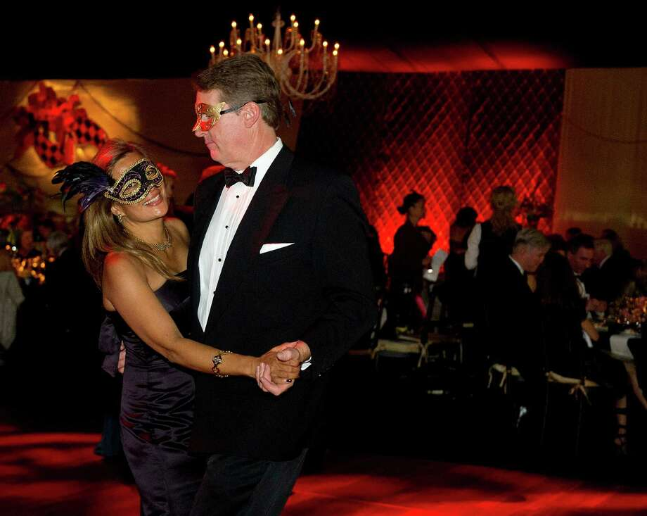 Attendees dance during the Venezia Gala honoring Frank Corvino and benefiting Oncology Services at Greenwich Hospital at the Greenwich Country Club on Saturday, October 25, 2014. Photo: Lindsay Perry / Stamford Advocate