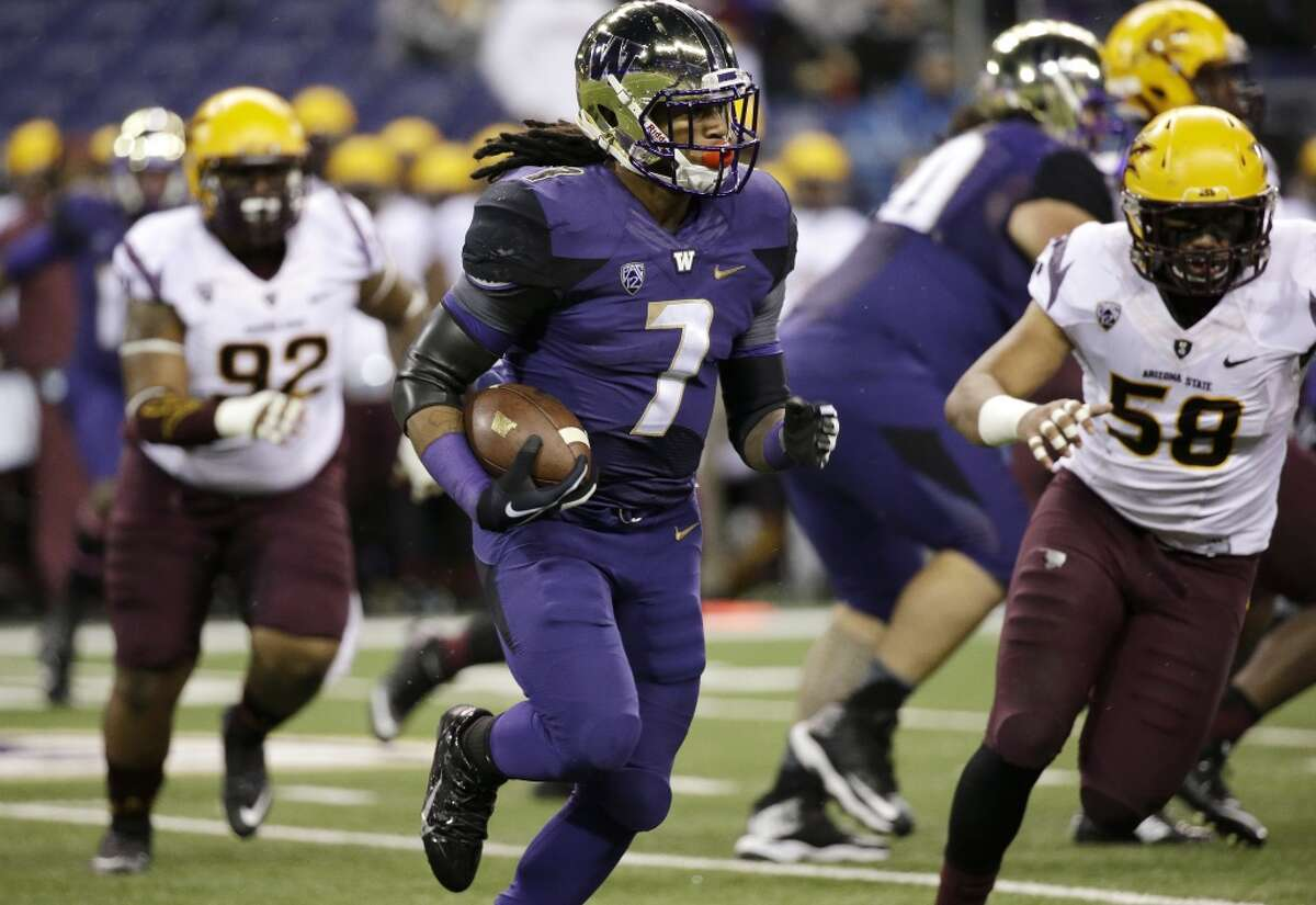 Washington's Shaq Thompson carries against Arizona State during the first half of an NCAA college football game Saturday, Oct. 25, 2014, in Seattle. (AP Photo/Elaine Thompson)