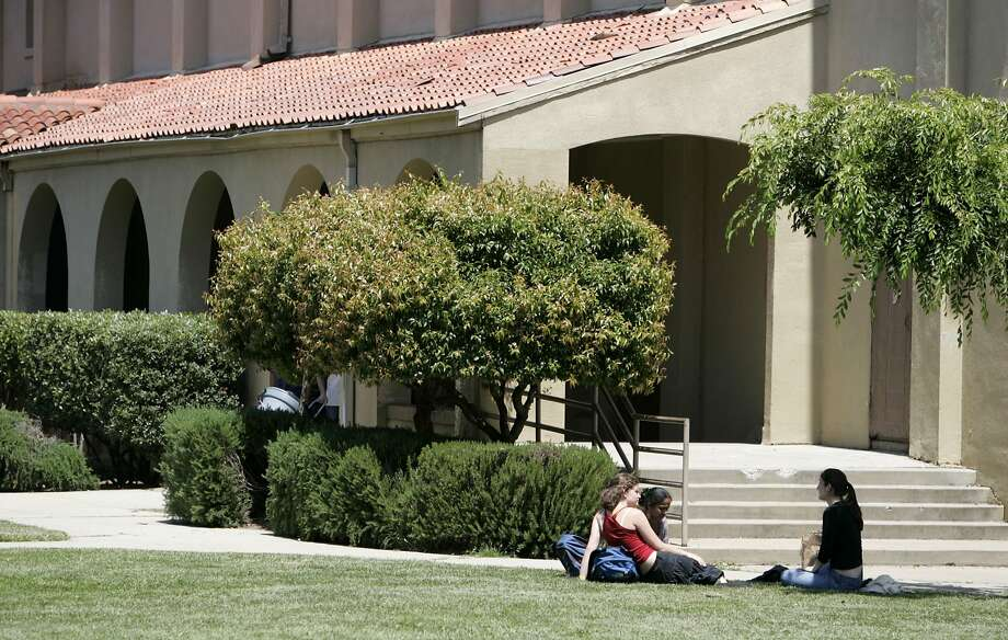 In this file photo, students relax on the quad at Palo Alto High School. Photo: Paul Chinn, The Chronicle