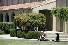 """Students relax on the quad at Palo Alto High School.In May, Palo Alto Unified School District hired Glenn """"Max"""" McGee as its superintendent by offering a four-year contract with annual pay starting at $295,000 to work 224 days, a $1 million interest-free home loan, a $9,000-a-year car allowance, and $6,000-a-year for life insurance premiums."""