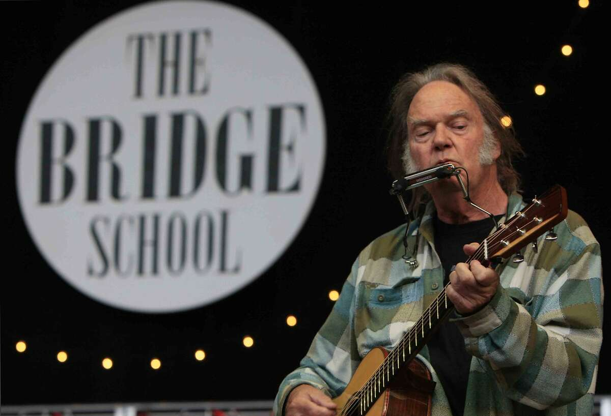 Neil Young performs during the 28th annual Bridge School Benefit Concert at Shoreline Amphitheater in Mountain View, Calif. Saturday, October 25, 2014.