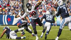 Houston Texans outside linebacker Jadeveon Clowney (90) applies pressure to Tennessee Titans quarterback Zach Mettenberger (7) during the first half an NFL football game at LP Field on Sunday, Oct. 26, 2014, in Nashville. ( Smiley N. Pool / Houston Chronicle )
