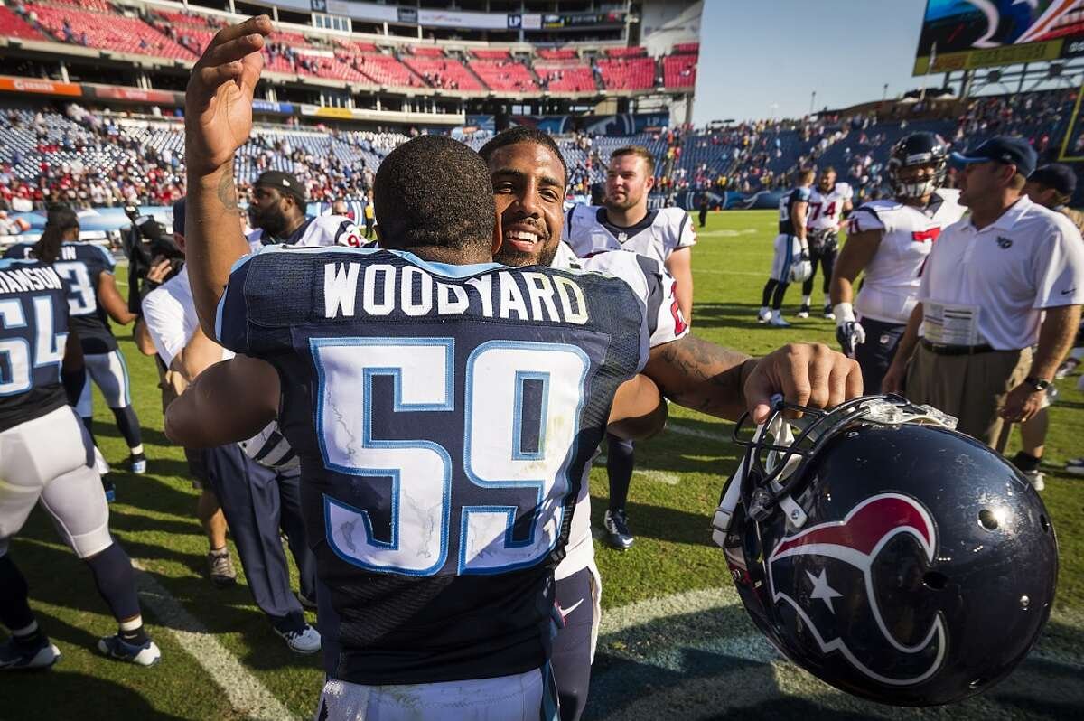 Houston Texans running back Arian Foster (23) hugs Tennessee Titans inside linebacker Wesley Woodyard (59) after a 30-16 victory over the Titans in an NFL football game at LP Field on Sunday, Oct. 26, 2014, in Nashville. ( Smiley N. Pool / Houston Chronicle )