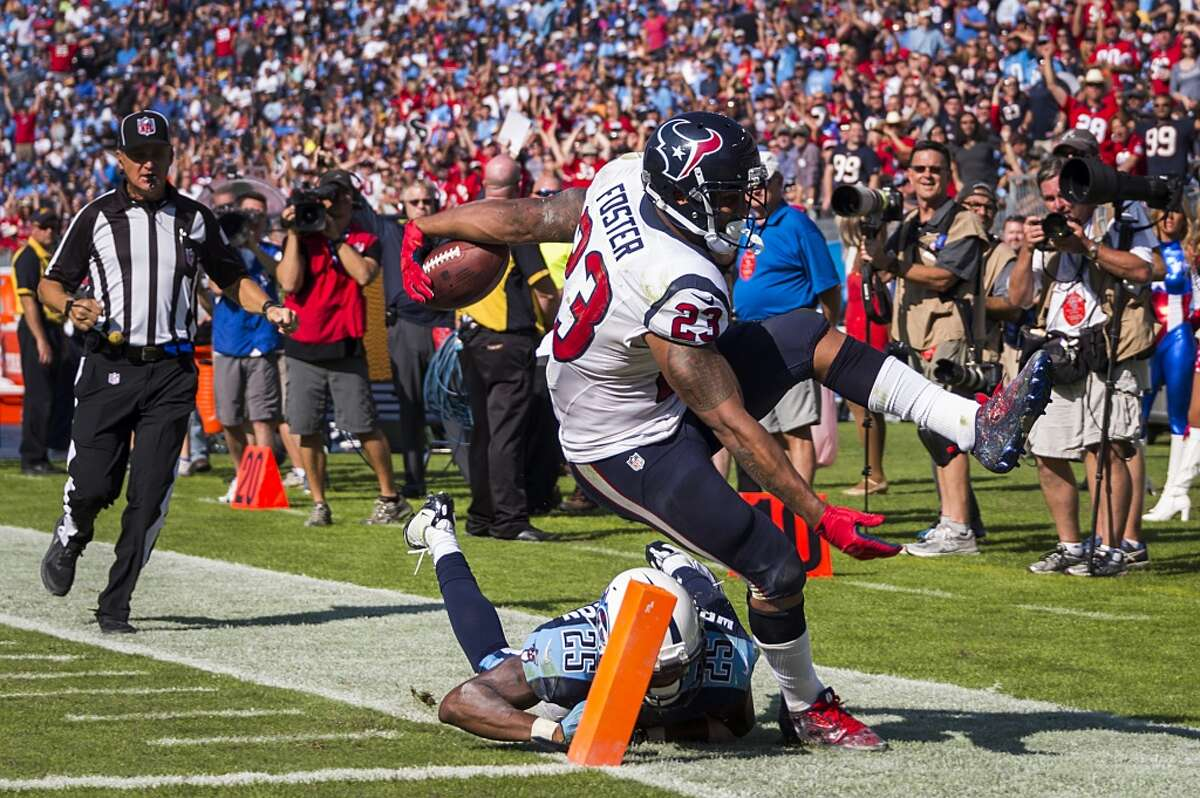 Houston Texans running back Arian Foster (23) is knocked out of bounds by Tennessee Titans cornerback Blidi Wreh-Wilson (25) just short of the end zone on a 43-yard run to set up a touchdown during the second half an NFL football game at LP Field on Sunday, Oct. 26, 2014, in Nashville. ( Smiley N. Pool / Houston Chronicle )