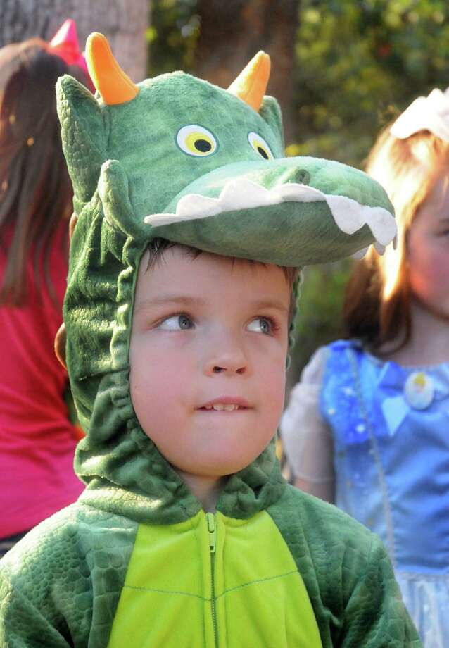 Emerson Smith hopes his dragon costume will keep the other scary characters away from him during the Halloween at the Y, at the Creekside YMCA. Costumed children and their parents walked the trails and visited the Trick & Treat stops along the way. Photo: David Hopper, Freelance / freelance