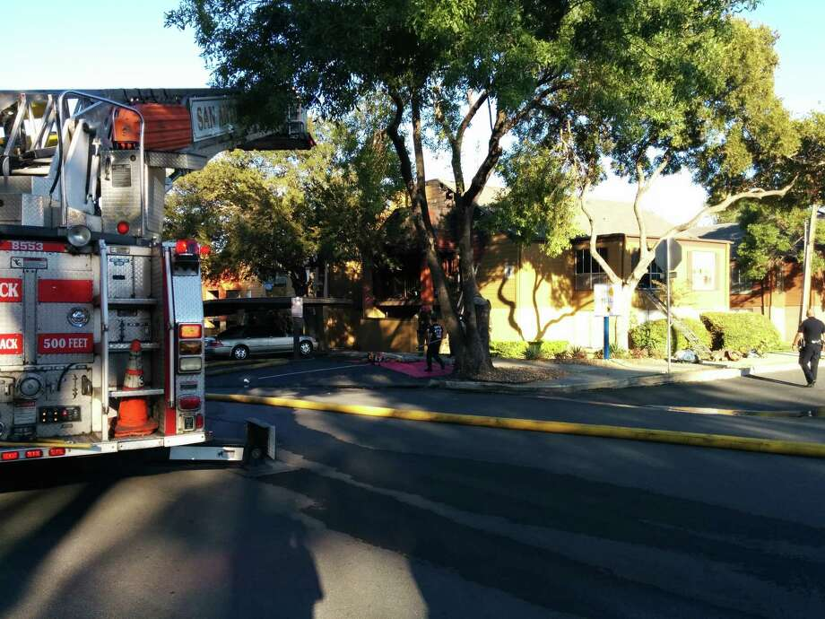 The San Antonio Fire Department sent 26 units to a fire at an apartment complex in the 3500 block of Pinn Oak Drive. Photo: By Jacob Beltran, San Antonio Express-News