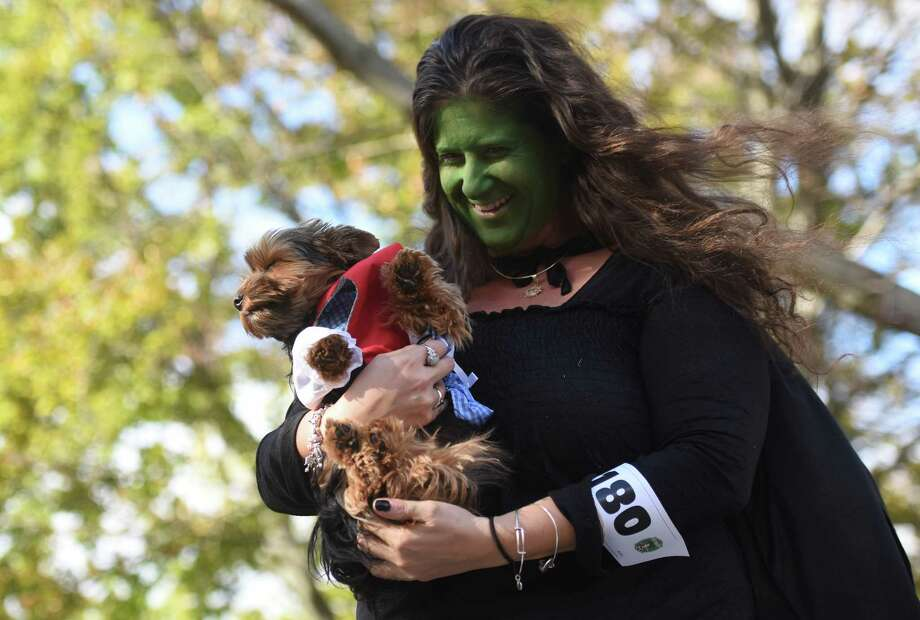 Photos from the annual Howl and Prowl pet costume party at the Greenwich Commons Park in Greenwich, Conn. Sunday, Oct. 26, 2014.  Hundreds gathered in the park to watch dogs and their owners strut across stage in a variety of unique costumes to benefit Adopt-A-Dog. Photo: Tyler Sizemore / Greenwich Time