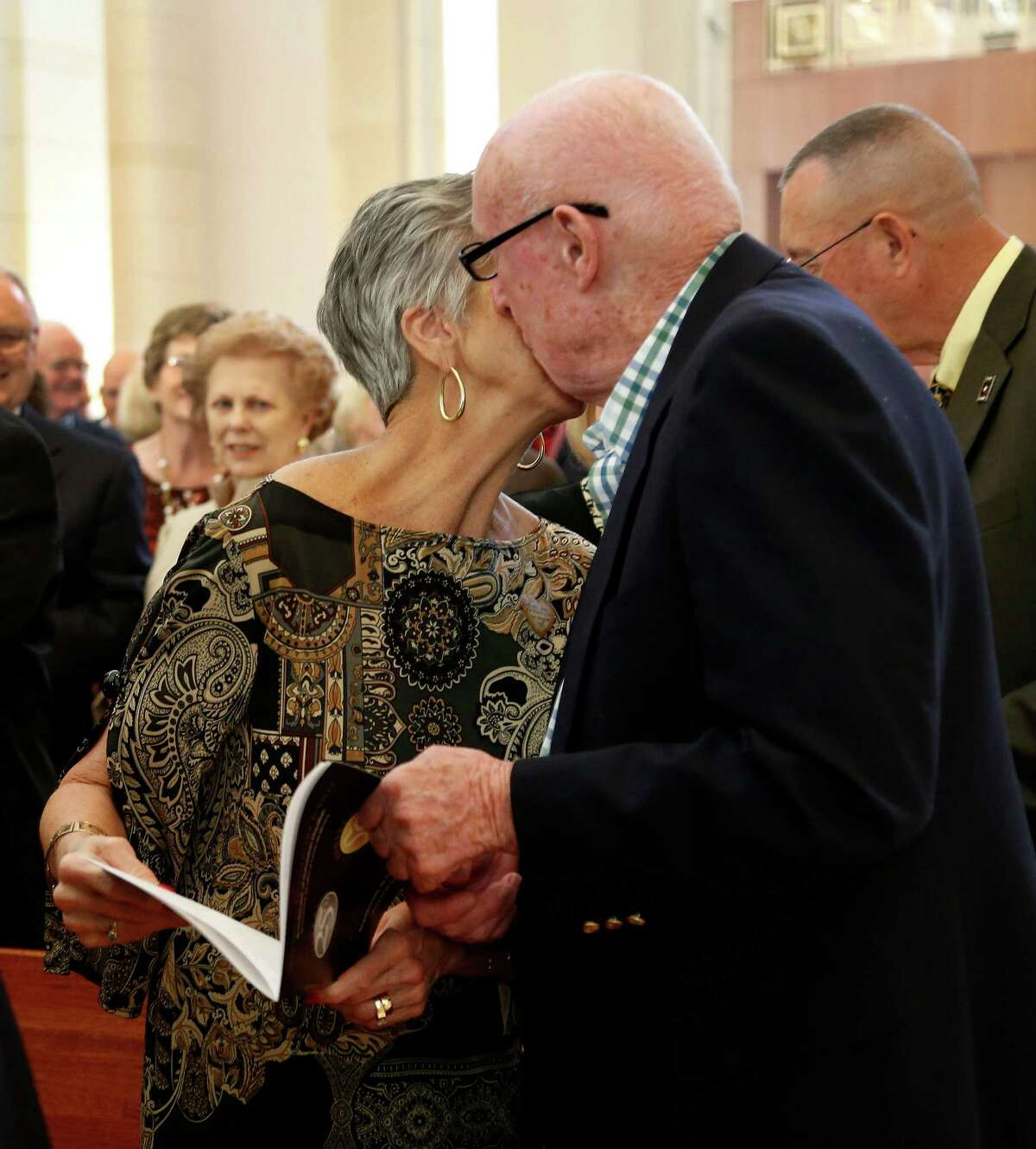Bert and Joann Campbell, married 50 years, kiss after a brief ceremony during the 2014 Wedding Anniversary Jubilee Mass at the Co-Cathedral of the Sacred Heart, Sunday, Oct. 26, 2014, in Houston. Cardinal Daniel DiNardo presided over the annual Mass that recognizes the commitment to the importance and permanence of marriage.