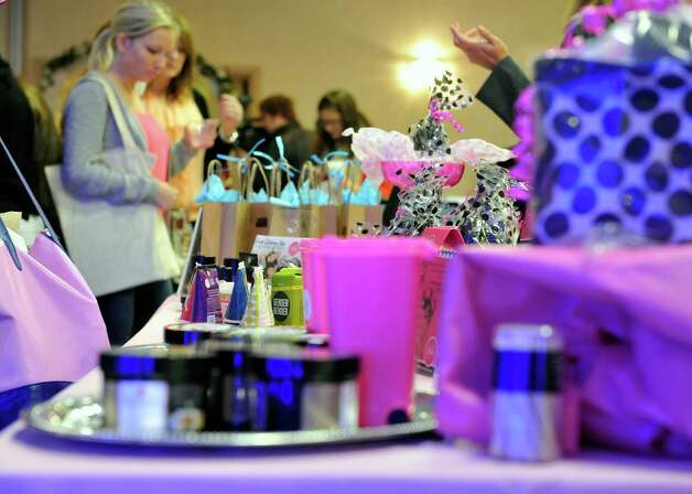 Women look over the different bridal vendors during the Brides Against Breast Cancer event at the Best Western Albany Airport Inn on Sunday, Oct. 26, 2014, in Albany, N.Y. The event sells donated wedding dresses and funds raised go towards programs for cancer patients and their families.  (Paul Buckowski / Times Union) Photo: Paul Buckowski / 00029195A