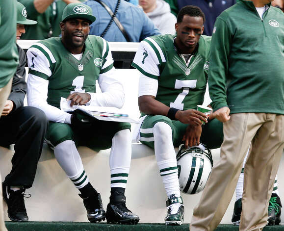 New York Jets quarterback Geno Smith (7) and Michael Vick (1) sit on the bench during the first half of an NFL football game against the Buffalo Bills, Sunday, Oct. 26, 2014, in East Rutherford, N.J. (AP Photo/Kathy Willens) ORG XMIT: ERU109 Photo: Kathy Willens / AP