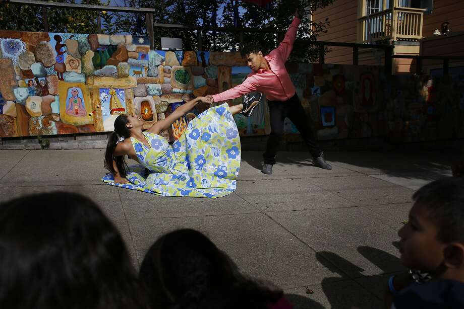 Lena Koenig and  Jose Carlos with Alayo Dance Company performs for a group of San Francisco students at the annual Trolly Dances and Kids on Track performances near 30th and Church Streets in San Francisco, Calif. Photo: Mike Kepka, The Chronicle