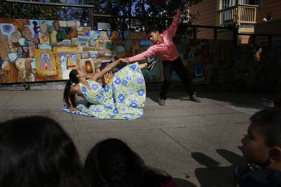 Lena Koenig and  Jose Carlos with Alayo Dance Company performs for a group of San Francisco students at the annual Trolly Dances and Kids on Track performances near 30th and Church Streets in San Francisco, Calif.