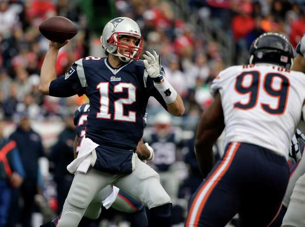 New England Patriots quarterback Tom Brady (12) passes over Chicago Bears defensive end Lamarr Houston (99) in the first half of an NFL football game on Sunday, Oct. 26, 2014, in Foxborough, Mass. (AP Photo/Steven Senne) ORG XMIT: FBO1 Photo: Steven Senne / AP