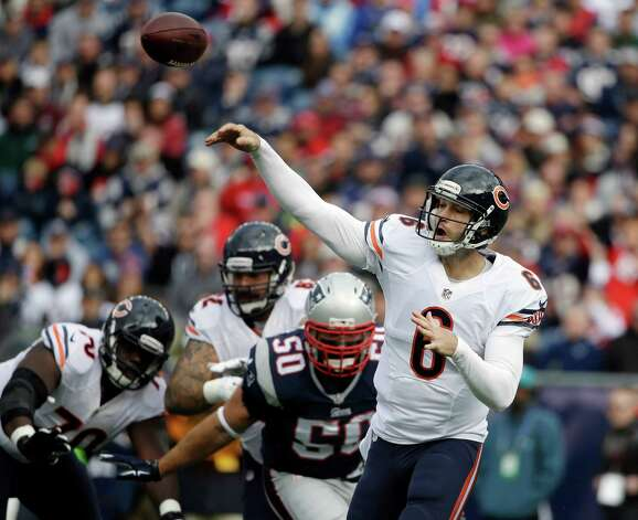 Chicago Bears quarterback Jay Cutler (6) passes in front of a rush by New England Patriots defensive end Rob Ninkovich (50) in the first half of an NFL football game on Sunday, Oct. 26, 2014, in Foxborough, Mass. (AP Photo/Steven Senne) ORG XMIT: FBO107 Photo: Steven Senne / AP