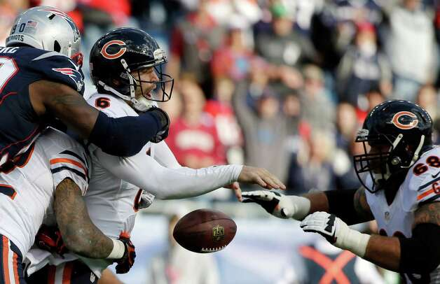 New England Patriots defensive end Zach Moore (90) forces Chicago Bears quarterback Jay Cutler (6) to fumble in the first half of an NFL football game on Sunday, Oct. 26, 2014, in Foxborough, Mass. (AP Photo/Steven Senne) ORG XMIT: FBO115 Photo: Steven Senne / AP