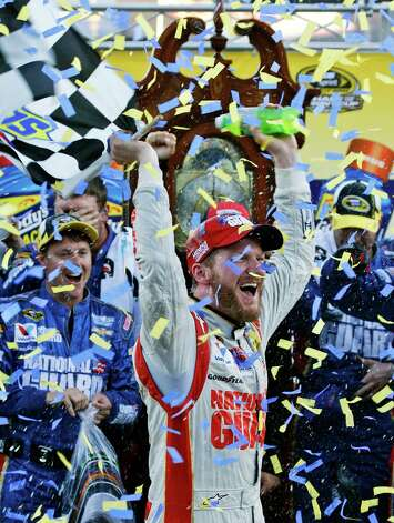Dale Earnhardt Jr. celebrates after winning the NASCAR Sprint Cup Series auto race at Martinsville Speedway in Martinsville, Va., Sunday, Oct. 26, 2014. (AP Photo/Steve Helber) ORG XMIT: VASH122 Photo: Steve Helber / AP