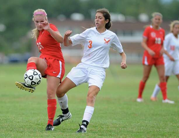 Niskayuna's Hannah Munro, left, battles for the ball with Bethlehem's Holly Moore during a soccer game on Tuesday, Sept. 16, 2014 in Delmar, N.Y. (Lori Van Buren / Times Union) Photo: Lori Van Buren / 00028610A