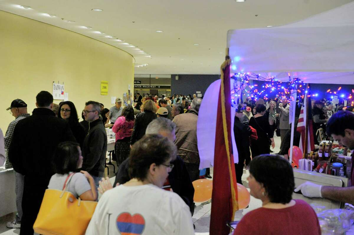 Visitors purchase ethnic food at the different booths at the 43rd annual Festival of Nations at the Empire State Plaza Convention Center on Sunday, Oct. 26, 2014, in Albany, N.Y. (Paul Buckowski / Times Union)