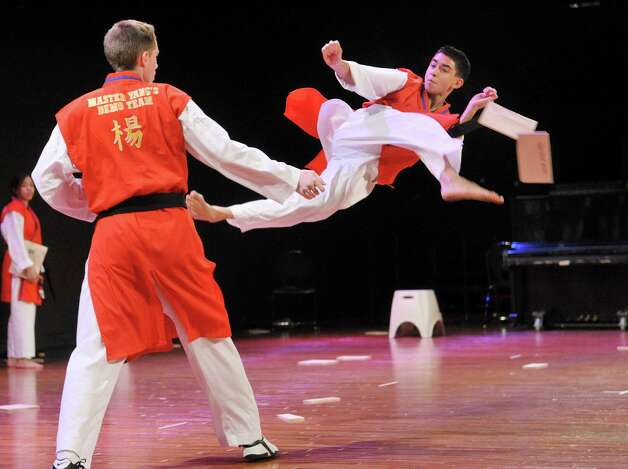 Representing the Republic of Korea, Michael Zervos, a student from Master Yang's Martial Arts Center in Latham, breaks a board with his foot during the 43rd annual Festival of Nations at the Empire State Plaza Convention Center on Sunday, Oct. 26, 2014, in Albany, N.Y.  (Paul Buckowski / Times Union) Photo: Paul Buckowski / 00029125A