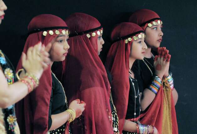 Girls with the Organization of Bangladeshi American Community, from left to right, Dia Aafreen, Prova Rahman, Arpie Rahman and Maha Khair watch from off stage as some of their fellow dancers perform during the 43rd annual Festival of Nations at the Empire State Plaza Convention Center on Sunday, Oct. 26, 2014, in Albany, N.Y.  (Paul Buckowski / Times Union) Photo: Paul Buckowski / 00029125A