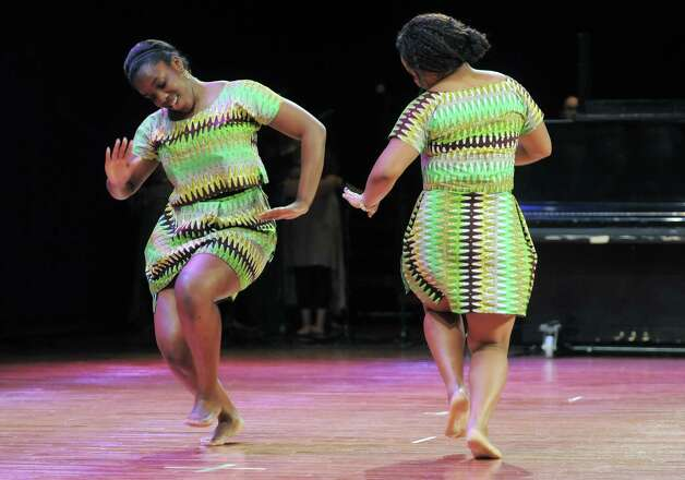 Representing Nigeria, Tamara Akangbou, left, and Idy Essien perform a Nigerian cultural dance during the 43rd annual Festival of Nations at the Empire State Plaza Convention Center on Sunday, Oct. 26, 2014, in Albany, N.Y.  (Paul Buckowski / Times Union) Photo: Paul Buckowski / 00029125A