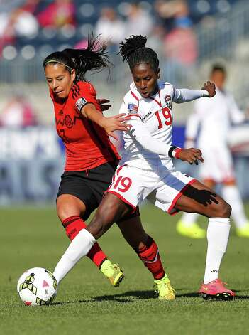 Mexico forward Veronica Perez (17) battles Trinidad and Tobago forward Kennya Cordner (19) for control of the ball in the first half during a CONCACAF consolation soccer match in Chester, Pa., Sunday, Oct. 26, 2014. (AP Photo/Rich Schultz) ORG XMIT: PARS103 Photo: Rich Schultz / FR27227 AP