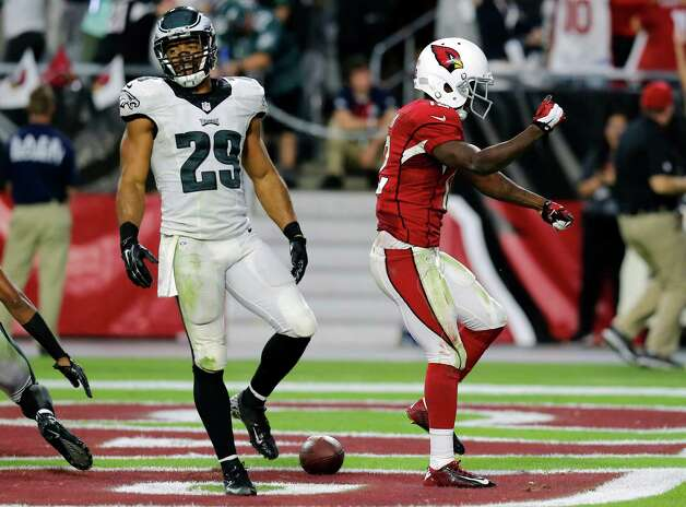 Arizona Cardinals wide receiver John Brown (12) celebrates his touchdown as Philadelphia Eagles strong safety Nate Allen (29) walks away during the second half of an NFL football game, Sunday, Oct. 26, 2014, in Glendale, Ariz. (AP Photo/Rick Scuteri) ORG XMIT: AZMY147 Photo: Rick Scuteri / FR157181 AP