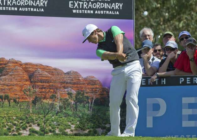 Thorbjorn Olesen of Denmark drives from the 17th tee during the final day of the 2014 Perth International Golf tournament at Lake Karrinyup Country Club in Perth on October 26, 2014.   AFP PHOTO/Tony ASHBY       IMAGE STRICTLY FOR EDITORIAL USE - STRICTLY NO COMMERCIAL USETONY ASHBY/AFP/Getty Images Photo: TONY ASHBY / Copyright 2014