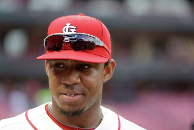 FILE - In this May 31, 2014, file photo, St. Louis Cardinals' Oscar Taveras smiles after the Cardinals' 2-0 victory over the San Francisco Giants in a baseball game in St. Louis. Taveras died Sunday Oct. 26, 2014 in an auto accident in his native Dominican Republic, according to Angel Ovalles, the Cardinals' representative in the Caribbean country. (AP Photo/Jeff Roberson,File) ORG XMIT: XLAT108 Photo: Jeff Roberson / AP