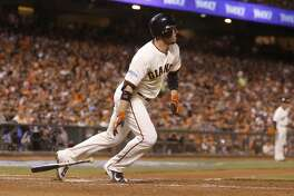 Giants Travis Ishikawa hits a single in the sixth inning during Game 5 of the World Series at AT&T Park on Sunday, Oct. 26, 2014 in San Francisco, Calif.