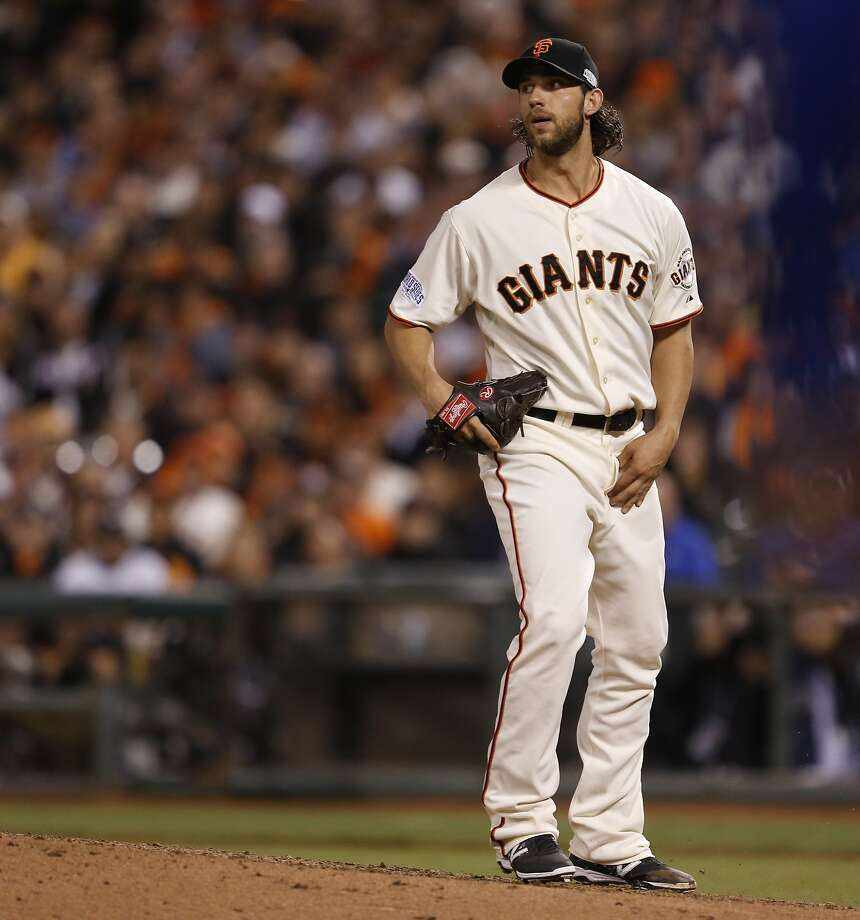 Giants Madison Bumgarner watches a Royals Omar Infante double in the fifth inning during Game 5 of the World Series at AT&T Park on Sunday, Oct. 26, 2014 in San Francisco, Calif. Photo: Scott Strazzante, The Chronicle