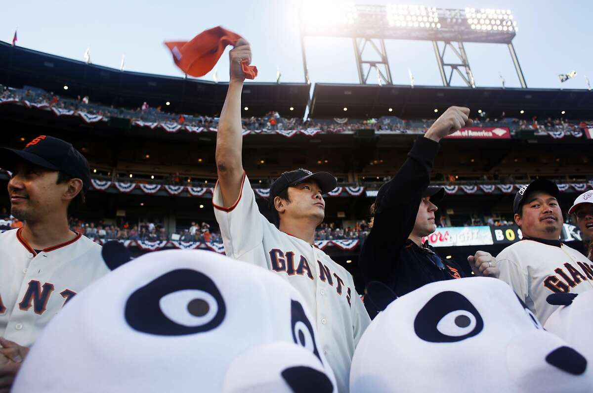 San Francisco Giants fans cheer at the start of game five of the World Series against the Kansas City Royals at AT&T Park on October 26, 2014 in San Francisco, Calif.