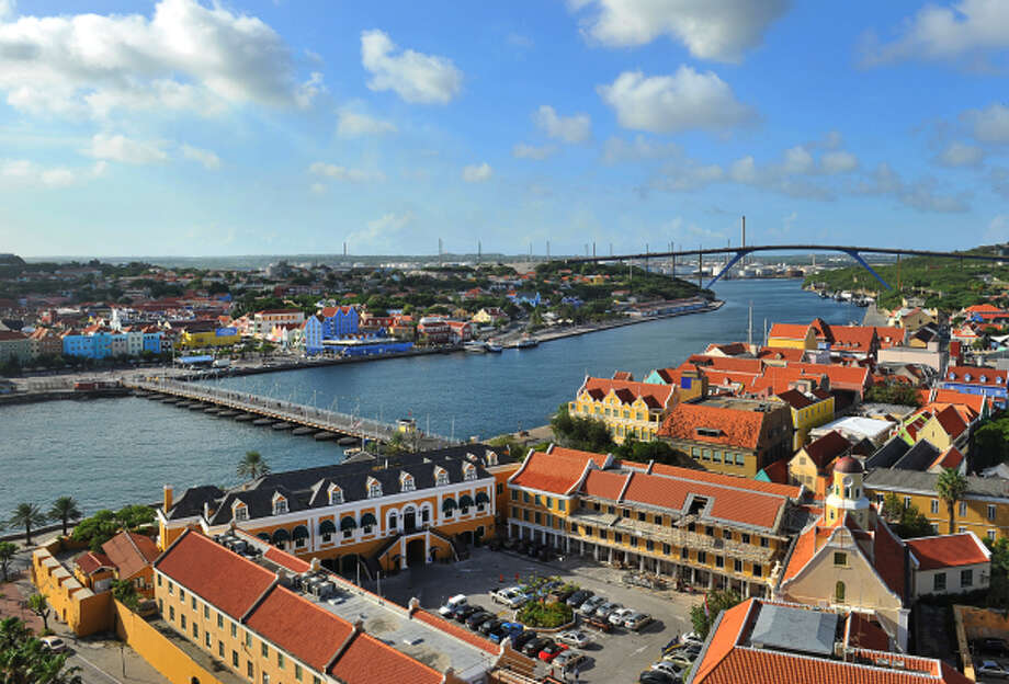 The inaugural KLM Curacao Marathon on Nov. 30 traverses the island's capital of Willemstad, which includes the Queen Emma pontoon bridge (foreground) and the 185-foot-high Juliana Bridge, one of the world's tallest. Photo: Curacao Tourist Board / ONLINE_YES
