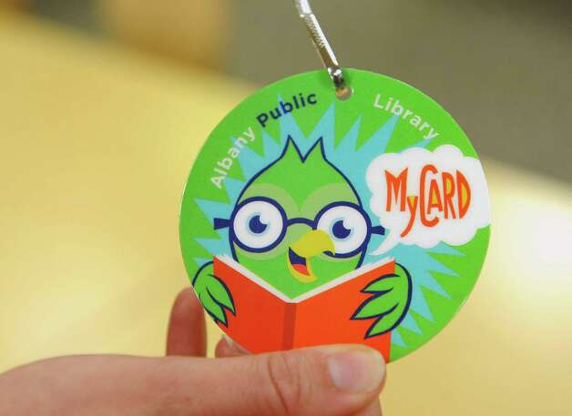 An Albany Public Library MyCard is shown for an initiative for children at the Albany Public Library Tuesday, June 17, 2014 in Albany, N.Y. The initiative was announced by Albany Public Library, Albany Mayor Kathy Sheehan and the City School District.  (Lori Van Buren / Times Union) Photo: Lori Van Buren / 00027391A