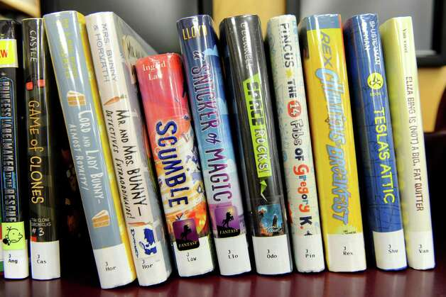 Books on a shelf at the Albany Public Library Tuesday, June 17, 2014 in Albany, N.Y. An initiative for children to offer the APL MyCard was announced by Albany Public Library, Albany Mayor Kathy Sheehan and the City School District.  (Lori Van Buren / Times Union) Photo: Lori Van Buren / 00027391A