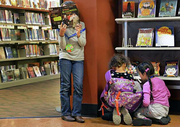 Children reading in the Delaware branch of the Albany Public Library after school Thursday Oct. 9, 2014, in Albany, NY.  (John Carl D'Annibale / Times Union) Photo: John Carl D'Annibale / 10028956A