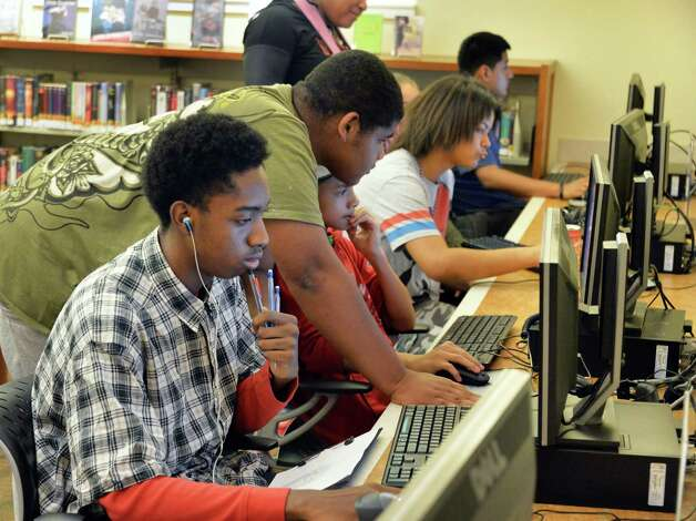 Older teens on computers in the Delaware branch of the Albany Public Library after school Thursday Oct. 9, 2014, in Albany, NY.  (John Carl D'Annibale / Times Union) Photo: John Carl D'Annibale / 10028956A