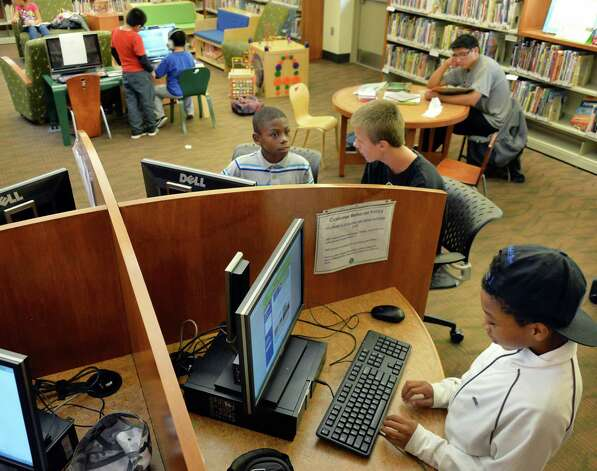 Kids fill the Delaware branch of the Albany Public Library after school Thursday Oct. 9, 2014, in Albany, NY.  (John Carl D'Annibale / Times Union) Photo: John Carl D'Annibale / 10028956A