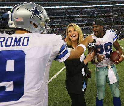 Cowboys QB Tony Romo congratulates DeMarco Murray while the RB is being interviewed after the Oct. 19 win over the Giants. Murray's efforts have made Romo even more effective. Photo: Ronald Martinez / Getty Images / 2014 Getty Images