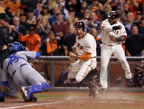 Giants Hunter Pence and Giants Pablo Sandoval celebrate their eighth inning score off a Juan Perez triple during Game 5 of the World Series at AT&T Park on Sunday, Oct. 26, 2014 in San Francisco, Calif. Photo: Scott Strazzante, The Chronicle / ONLINE_YES