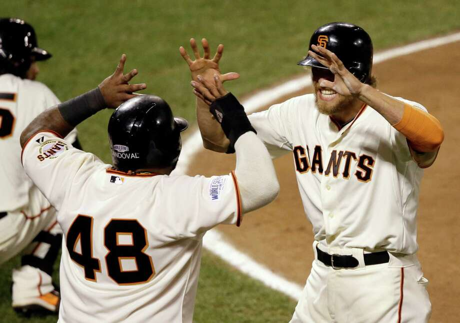 San Francisco Giants' Pablo Sandoval (48) and Hunter Pence celebrate after scoring on a double by Juan Perez during the eighth inning of Game 5 of baseball's World Series against the Kansas City Royals Sunday, Oct. 26, 2014, in San Francisco. (AP Photo/Eric Risberg) Photo: Eric Risberg, Associated Press / AP