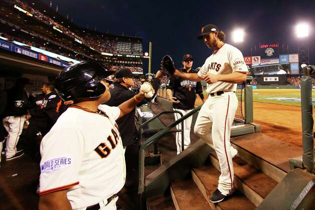SAN FRANCISCO, CA - OCTOBER 26: Madison Bumgarner #40 of the San Francisco Giants returns to the dugout after the fifth inning against the Kansas City Royals during Game Five of the 2014 World Series at AT&T Park on October 26, 2014 in San Francisco, California.  (Photo by Elsa/Getty Images) ORG XMIT: 519100383 Photo: Elsa / 2014 Getty Images
