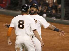 Giants Hunter Pence and Pablo Sandoval celebrate their eighth inning score during Game 5 of the World Series at AT&T Park on Sunday, Oct. 26, 2014 in San Francisco, Calif.